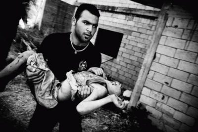 56 civilians were killed during an Israeli air strike on the village of Qana in the early hours of July 30th. Qana, Lebanon. July 2006